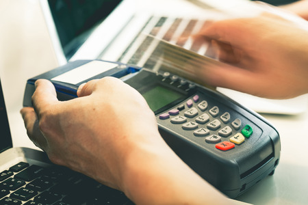 electronic card: Hand Swiping Credit Card In Store : Still-Life Processed