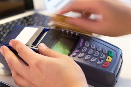 cardreader: Hand Swiping Credit Card In Store : Selective Focus