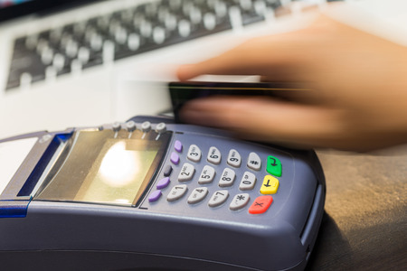 number card: Hand Swiping Credit Card In Store