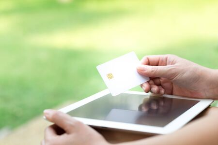 shopping online: Womans Hands Holding A Credit Card And Using Tablet PC. Online Shopping Concept