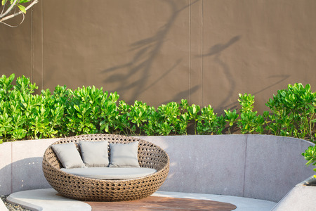 Relaxing Rattan Sofa In The Garden Stock Photo