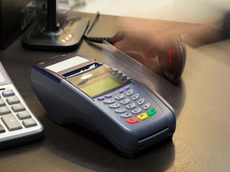 Motion of Hand Swiping Credit Card In Store