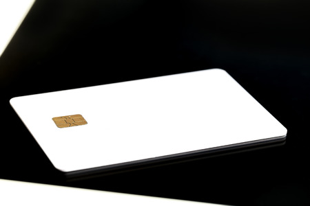 Selective Focus : Blank Credit Card With Electronic Chip On Personal Tablet PC