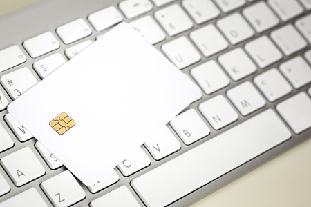 Blank Credit Card With Electronic Chip On Keyboard Stock Photo