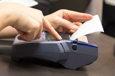 Hand With Credit Card Swipe Through Terminal For Sale In Store