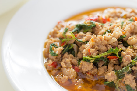 stir up: Close Up Image Of Spicy Stir Fried Minced Pork And Basil