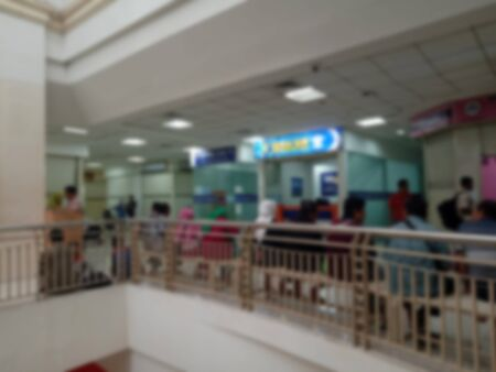 Blur Photo, Sitting and Queueing People for buying someting at Shopping Mall