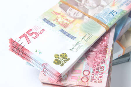 Random Layout Photo Rupiah Paper Money, 10000, 50000, 100000 and 75000 at White Background Stock fotó