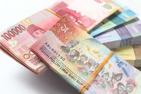 Random Layout Photo Rupiah Paper Money, 10000, 50000, 100000 and 75000 at White Background