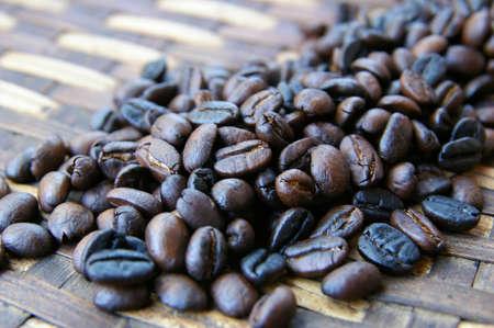 Dark brown coffee beans on a ratan tray Stock Photo