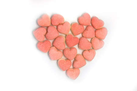 Small pink jelly candies forming a shape of a heart Stock Photo