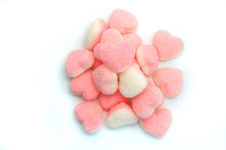 Hill formed by lots of small jelly candies in the shape of hearts Stock Photo