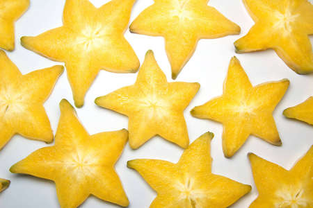 Lots of carambola slices forming a background Stock Photo