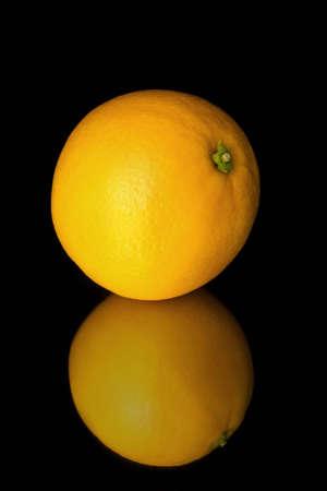 Shiny ripe orange isolated on the black background Stock Photo