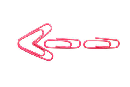 Pink arrow made from four pink paperclips iolated on the white background Stock Photo