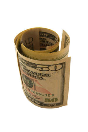 Fifty dollar bank notes in forming a roll isolated on the white background
