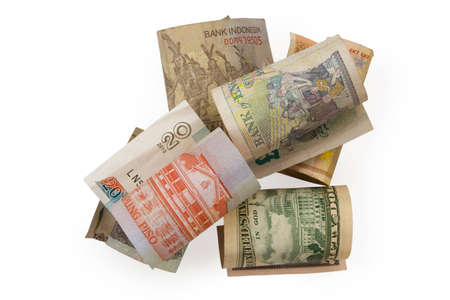 American dollar, british pound, philippine peso, indonesian rupiah and euro rolled into coils