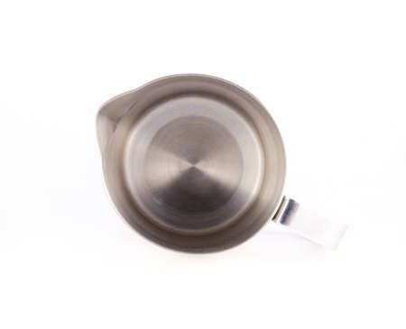 Stainless steel milk jug on the white background