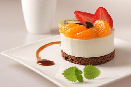 Cream dessert with fruit on white plate Stock Photo - 4550897