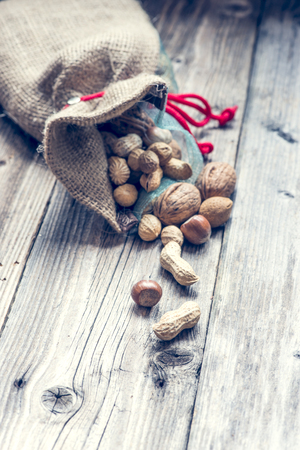 Biological nuts and almonds. Wood backgroud photo
