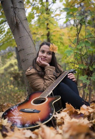 meditative: Meditative girl with a guitar in autumn