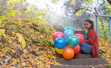 meditative: Meditative girl with her balloons