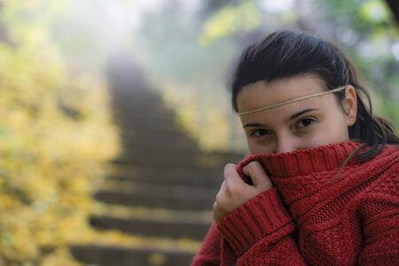 freezing: beautiful woman freezing in autumn park