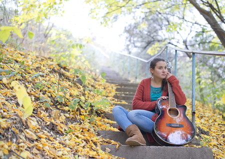 meditative: Meditative girl with her guitar Stock Photo