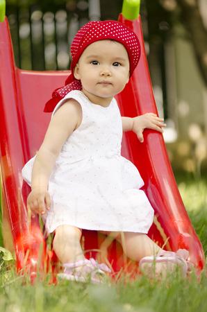 Little girl playing on slide Archivio Fotografico