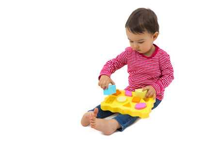 early education: little girl learning shapes, early education concept
