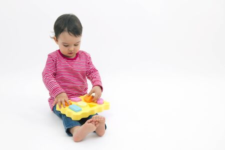 early education: little girl learning shapes, early education and daycare concept