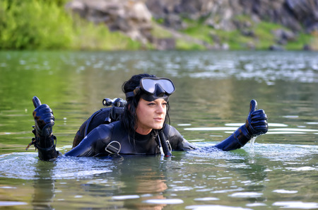 Beautiful woman diver making ok sign