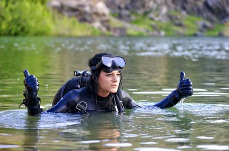 Beautiful woman diver making ok sign