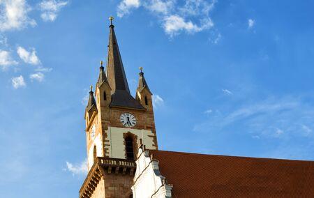 evangelical: church steeple of the evangelical church in Bistrita, Romania Stock Photo