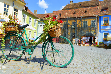 central square: Decorative Old Bicycle Equipped with Basket in central square
