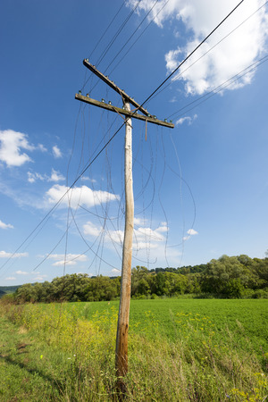 unnecessary: Old unnecessary wooden electrics pylon with broken wires