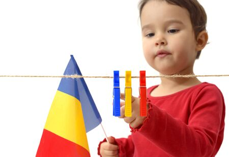 little girl with the romanian flag on white background Archivio Fotografico