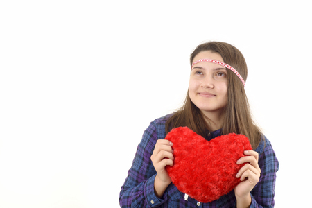 teen love: young girl holding a red heart