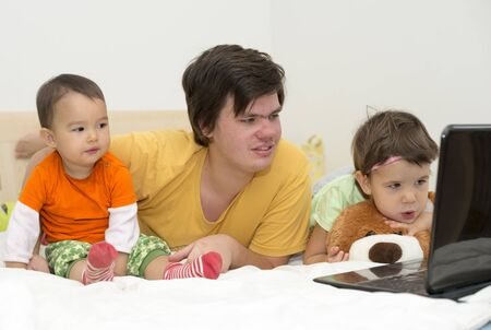 woman sleep: big brother watching cartoons with his younger sisters
