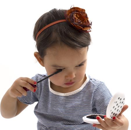 brash: Fashion little girl applying make up