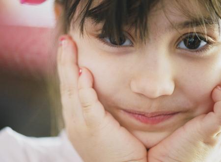 school aged: Portrait of beauty school aged brunette kid girl with black eyes indoor