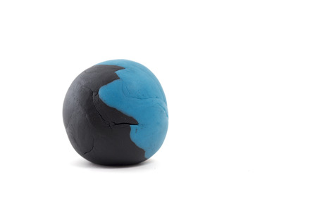 malleable: blue and black  plasticine ball on white background