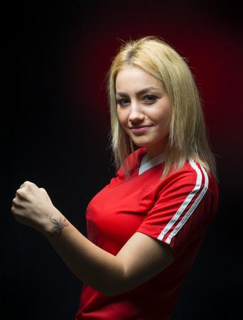 scoring: Happy woman soccer fan by scoring a goal