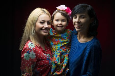 latin mother: Latin mother with daughter and aunt Stock Photo