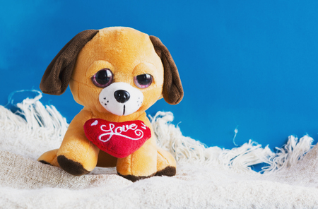 plush toy: plush toy dog with red heart