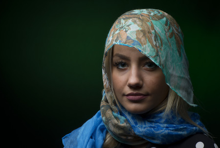 portait: Portait of woman wearing a blue scarf