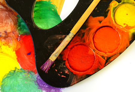 paintbox: Closeup of messy, used water-color paint-box and paint brush