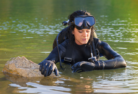 wetsuit: Beautiful woman diver