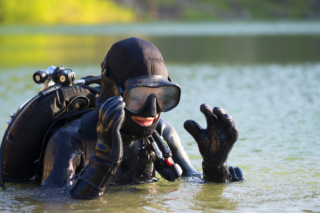 wetsuit: diver woman in the water Stock Photo