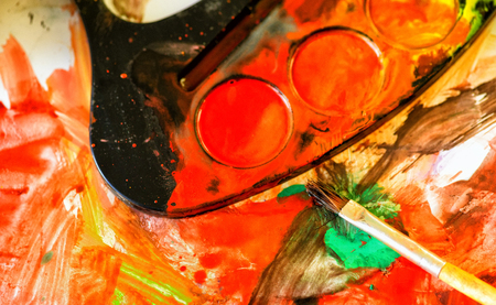 paintbox: Closeup of messy, used water-color paint box and paint brush